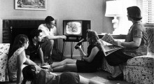 Family watching TV in the 1950s.