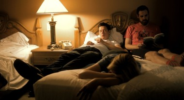 Alex, Jane and Russell rest in a Motel bedroom.