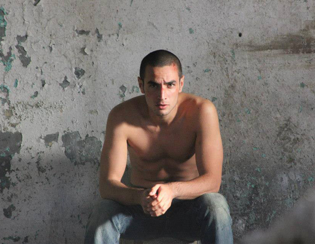 Omar (Adam Bakri) in Hany Abu-Assad's film. Image courtesy Adopt Films.