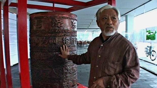 Li Xianting in 2010 (Tibetan art slideshow photo licensed under public domain via Wikimedia Commons)